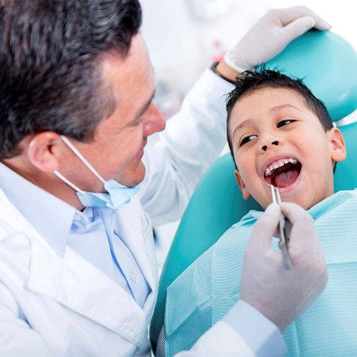 Dentist with black hair practicing children's dentistry in Greeley