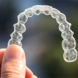 A man and woman smiling after Invisalign treatment