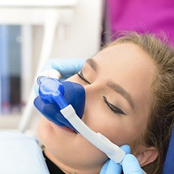 Woman in dental chair with nitrous oxide sedation dentistry mask