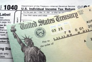 tax forms and a check from the United States Treasury