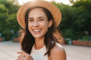 Woman smiling outside with dental implants